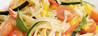 Spring vegetables add a pop of color and flavor to homemade fettuccine.