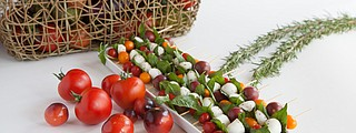 Caprese skewers are an easy, healthy appetizer to bring to a holiday party.