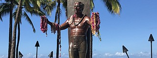 The statue of famed surfer Duke Kahanamoku has a prominent place along Waikiki Beach. Photo by Debbie Stone